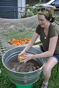 Jessie cleaning carrots.